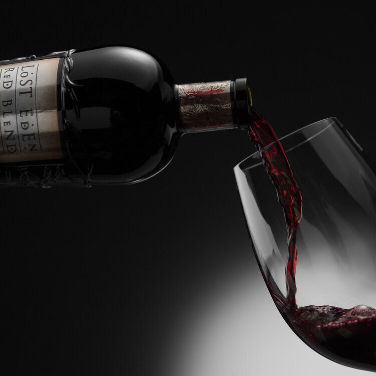 spotlight wine glass pour non vintage bottle shot red blendbog4142jpg